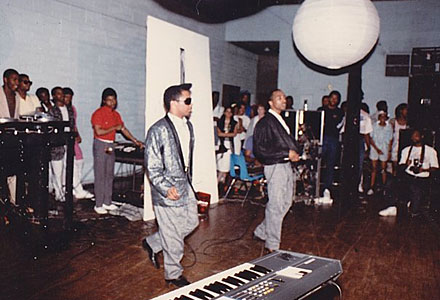 Chip E. and Keith Irving performing at Mendel Catholic Prep School