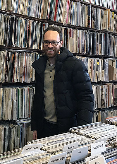 Jacob Arnold smiling in a record shop