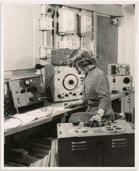 Daphne Oram composing on a synthesizer