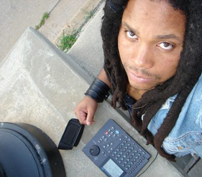 Jamal Moss outside with his drum machine